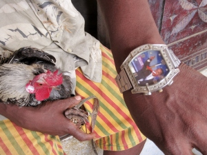 Mr. Bendu, Moyeahmoh village, displays his Obama watch.