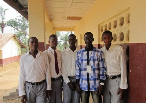 Student debaters at Walter Schutz Secondary School and their teacher after completing a debate.