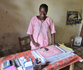 Nurse Adama is happy she safely delivered another baby at the village health clinic.
