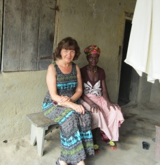 Masiry, oldest woman in village on her front porch with Arlene.