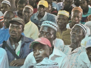 Chiefdom men learn about the promise of planting trees.