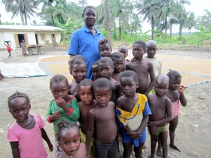 Chief Caulker with village children at his rice farm.