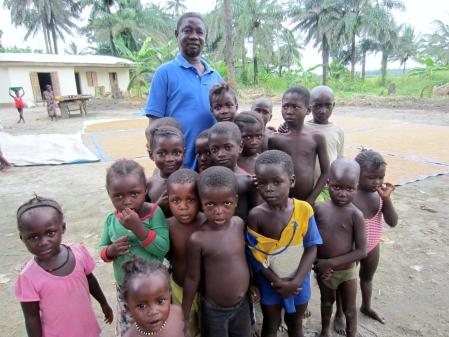 Chief Caulker with village children.