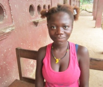 Kadiatu Sillah, 15 yrs, father died; no one can to pay for school; wants to learn  to be a seamstress and support her mother.