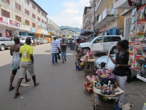 Main street in Freetown where small traders line the streets outside traditional businesses.