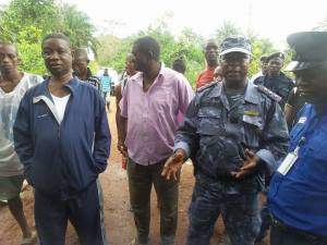 Chief Caulker (blue sports suit) inspecting chiefdom checkpoint.