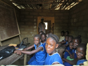 Primary school in Moyeamoh.  All but one of this sixth grade class are girls.
