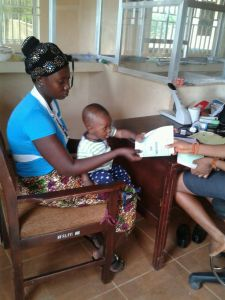 Mother bring her baby to register education savings account.