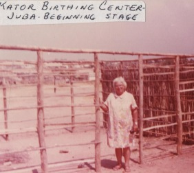 Winifred and frame of Kator BIrthing Center, Juba, Sudan