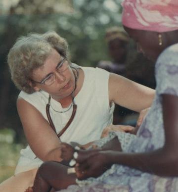 Winifred examining patient, Manjama, Sierra Leone